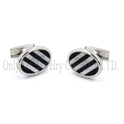 mother of pearl and black onyx setting on brass or silver cuff links